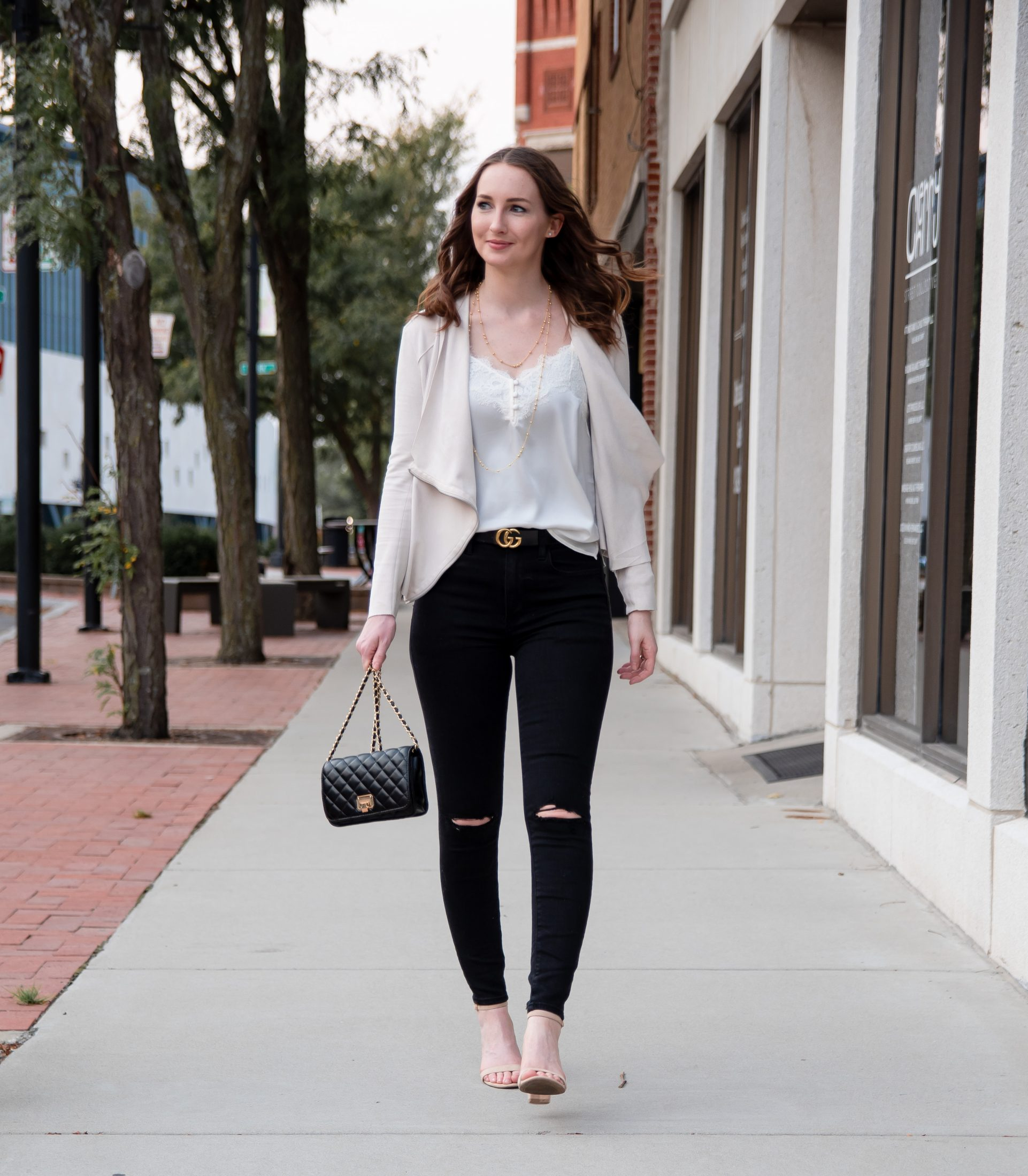 fall transitional outfit round up white lace cami black ripped jeans