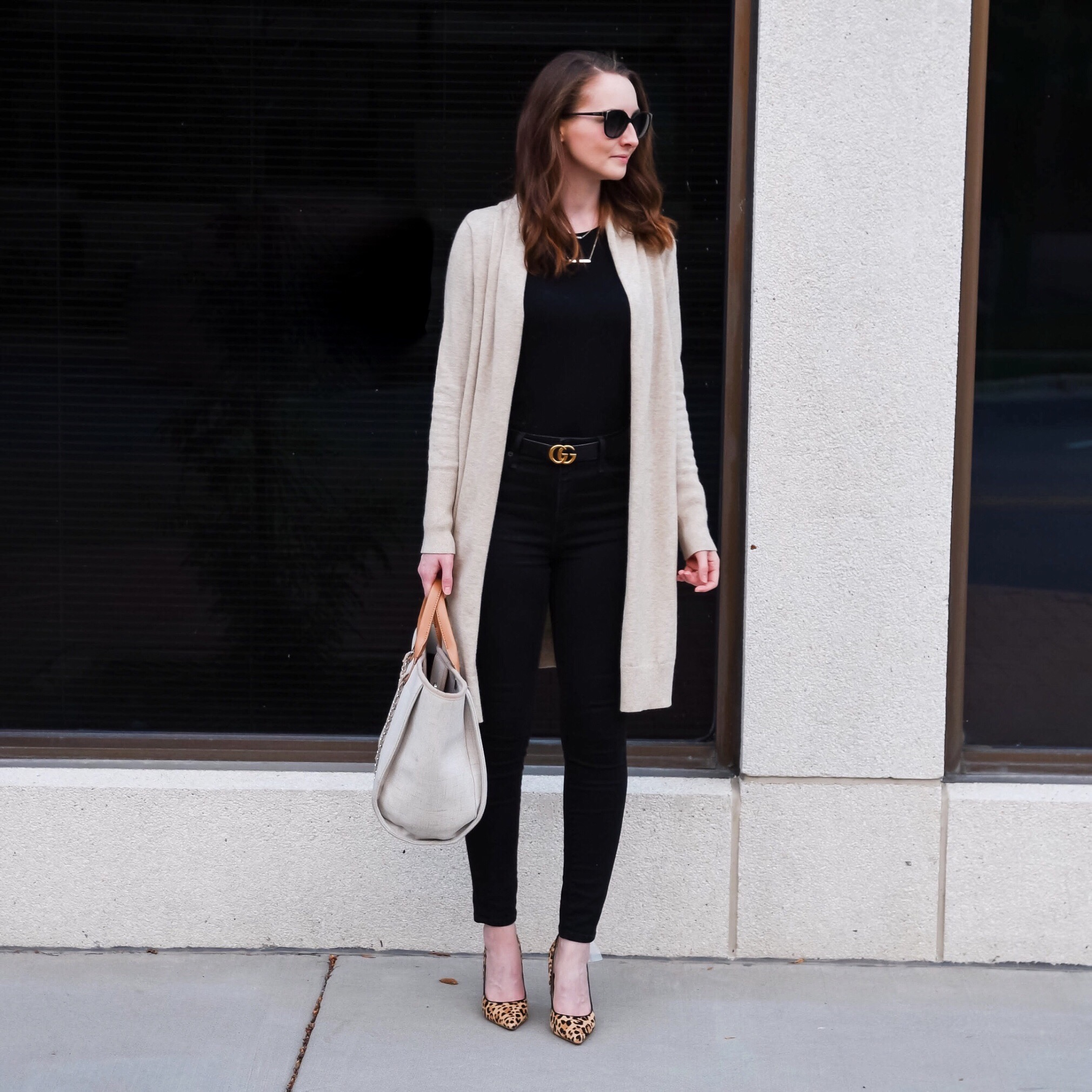 fall transitional outfit round up black shirt black jeans leopard shoes tan cardigan outfit